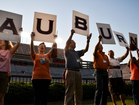 "Faculty holding letters ""A-U-B-U-R-N"""